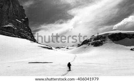 Hiker on snow plateau. Black and white panoramic view. Turkey, Central Taurus Mountains, Aladaglar (Anti-Taurus), plateau Edigel (Yedi Goller) - stock photo