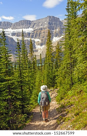 Hiker on the Helen Lake Trail Banff National Park - stock photo