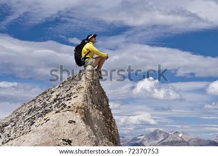 Hiker  on the summit. - stock photo