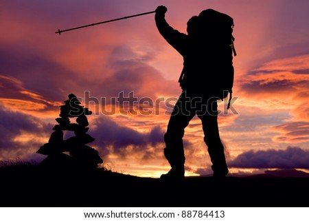 Hiker on the Top at Sunrise - stock photo