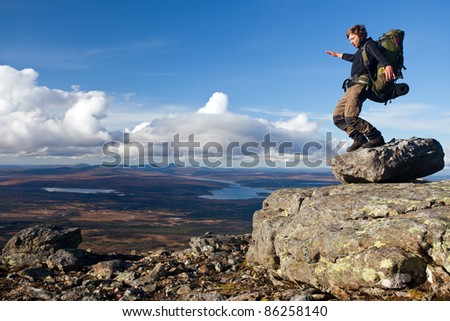 Hiker on the Top of the Mountain without balance - stock photo