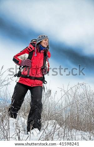 hiker on the winter snow field - stock photo
