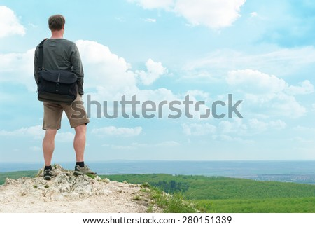 Hiker on top of the hill. - stock photo