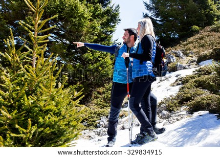 Hiker shows the way in the middle of the mountain - stock photo