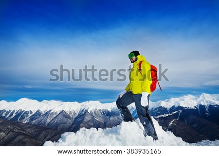 Hiker stand on top of the mountain peak