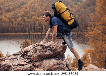 Hiker trekking in the mountains - stock photo