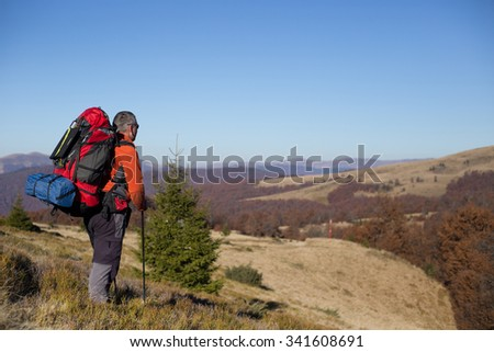 Hiker trekking in the mountains. Sport and active life