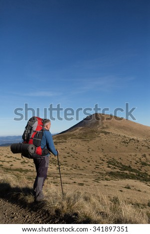 Hiker trekking in the mountains. Sport and active life.