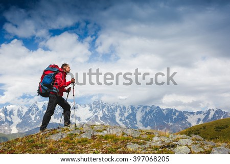 Hiker trekking in the mountains. Sport and active life - stock photo