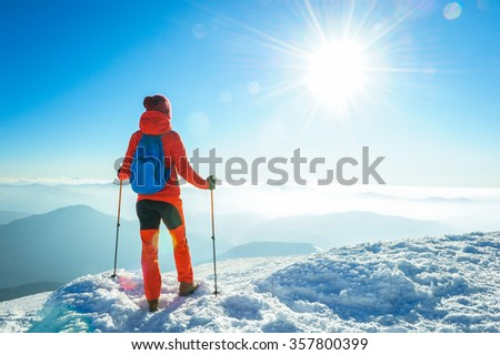 Hiker trekking in the winter mountains. Sport and active life