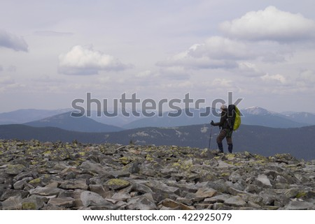 Hiker trekking traveler walking in the mountains