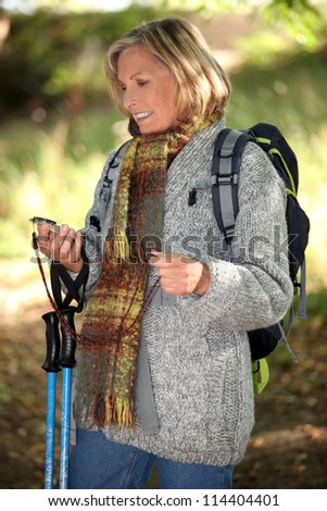 Hiker using a compass in the woods