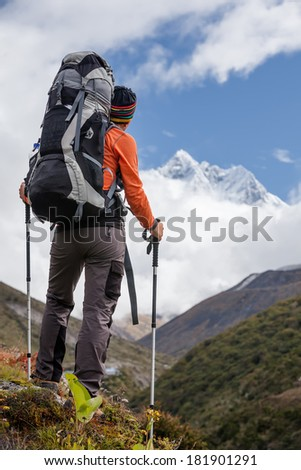 Hiker walks on trail in Himalayas - stock photo