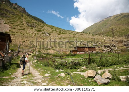 hiker with a backpack in the mountain. summer hiking - stock photo