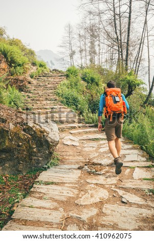 Hiker with backpack - stock photo