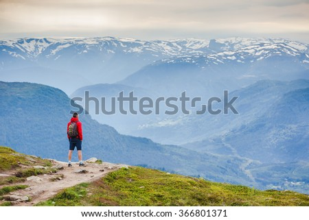 hiker with backpack enjoy sunny day - stock photo
