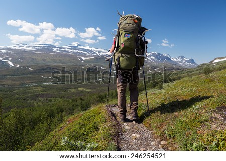 Hiker with Backpack in Northern Sweden - stock photo