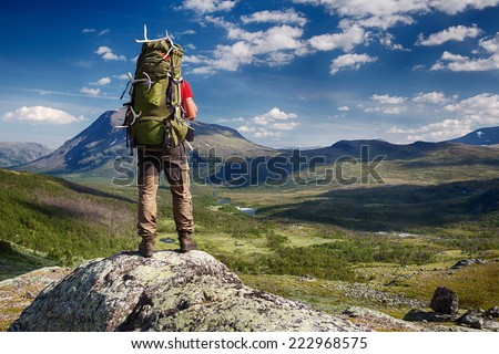 Hiker with Backpack in the wilderness of northern Sweden - stock photo