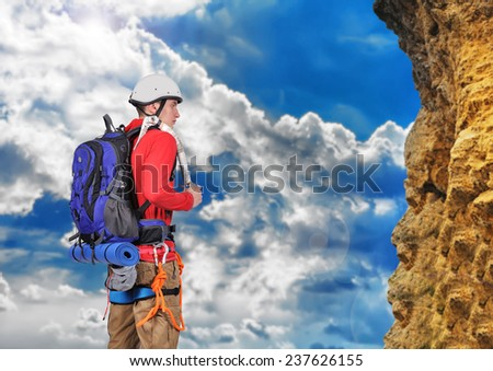 hiker with backpack looking to mountain - stock photo