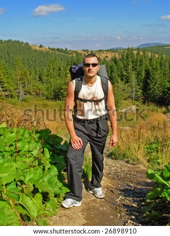 Hiker with rucksack in Carpathian Mountains, Ukraine - stock photo