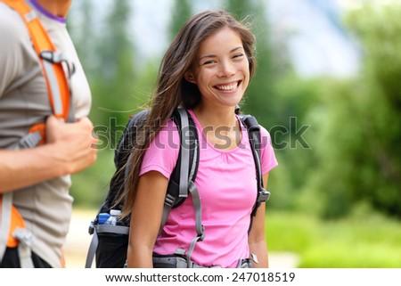 Hiker. Woman hiking smiling happy on trek with backpack during summer outdoors activity. Fresh joyful multiethnic Asian Caucasian female model walking in Yosemite National Park, California, USA - stock photo