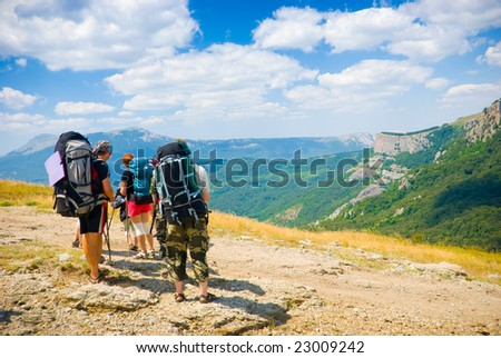 Hikers admire a scenery in Crimea mountains