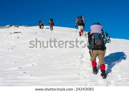 Hikers are in winter in mountains