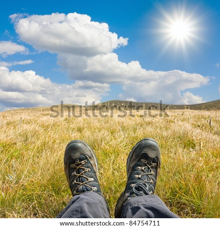 hikers boots on mountains meadow