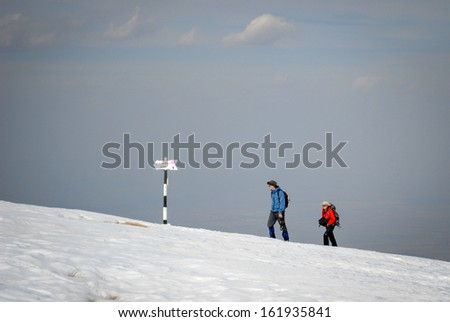 hikers couple team in the mountains.  - stock photo