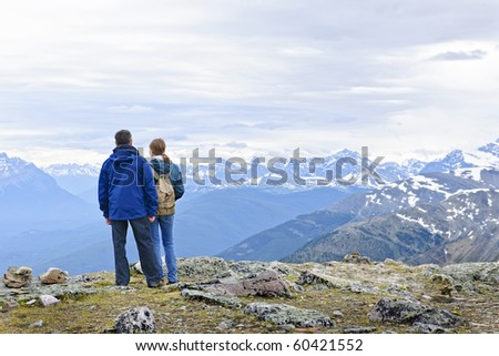 Hikers enjoying scenic Canadian Rocky Mountains view in Jasper National Park - stock photo