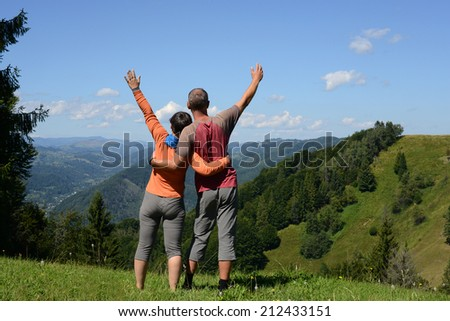 Hikers family a mountain pass  - stock photo