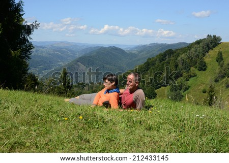 Hikers family resting a mountain pass