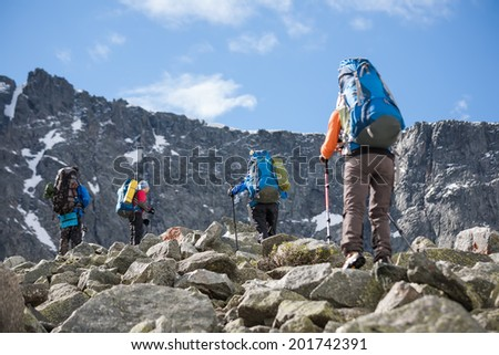 Hikers in Altai mountains, Russia - stock photo