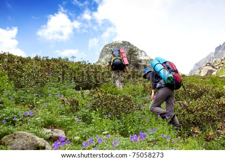 Hikers in Caucasus mountains - stock photo