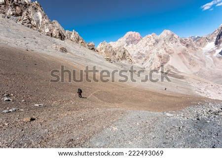 Hikers in high mountains, central asia, Tajikistan. - stock photo