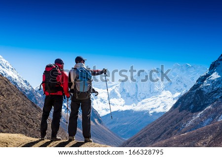 HIkers in Himalayas enjoying the view  - stock photo
