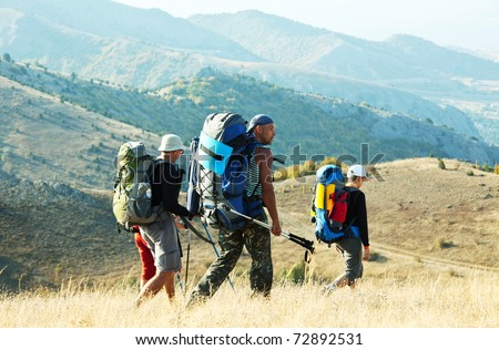 Hikers in summer Crimean mountains - stock photo