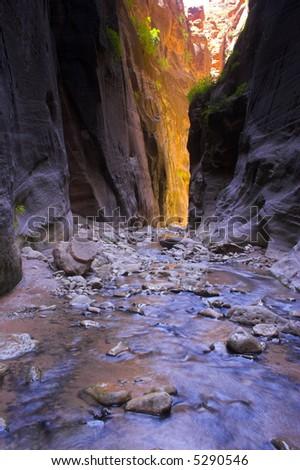 Hikers inside huge and narrow canyon - stock photo