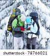 Hikers look for the path on the map - stock photo