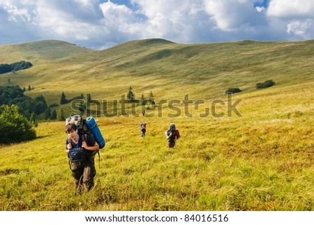 hikers on a hill slope