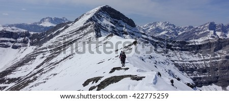 Hikers on a snow covered mountain