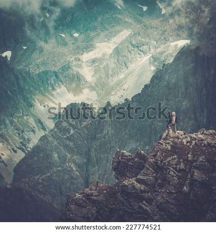 Hikers on a top of a mountain  - stock photo