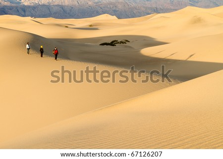 Hikers on an Early Morning Hike in the Desert - stock photo