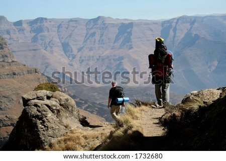 Hikers on footpath - stock photo