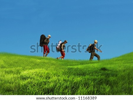 Hikers on grassland - stock photo