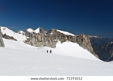 hikers on Mer de Glace glacier, Mont  Blanc massif - stock photo