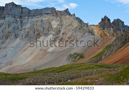 hikers on the trail to blue lakes pass in the mt sneffles wilderness san juan mountains colorado - stock photo