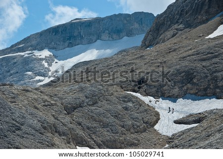 hikers on the way to the plateau of the Pale di San Martino, Dolomites - Italy - stock photo