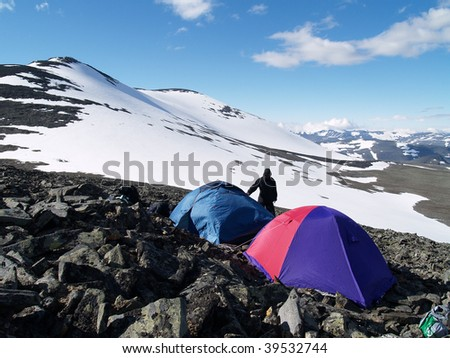 Hikers setting a camp in Tarfala area, Kebnekaise National Park, Lapland, Sweden