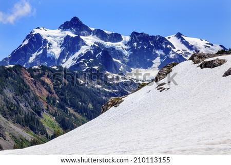 Hikers Snowfields Glaciers Artist Point Mount Shuksan Mount Baker Highway Snow Mountain Washington Pacific Northwest - stock photo